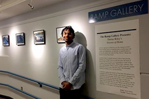 Darius Riley in front of his exhibition